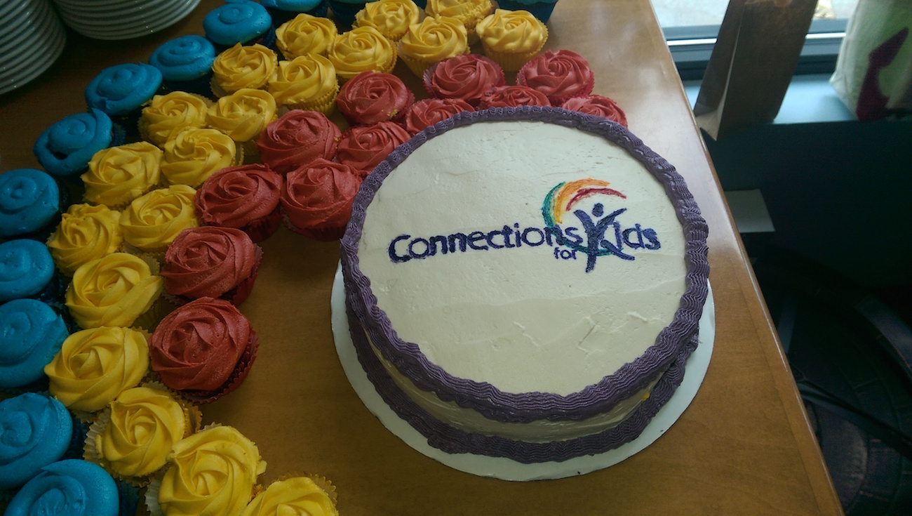 Picture of a cake on a table with the Connections For kids logo on it