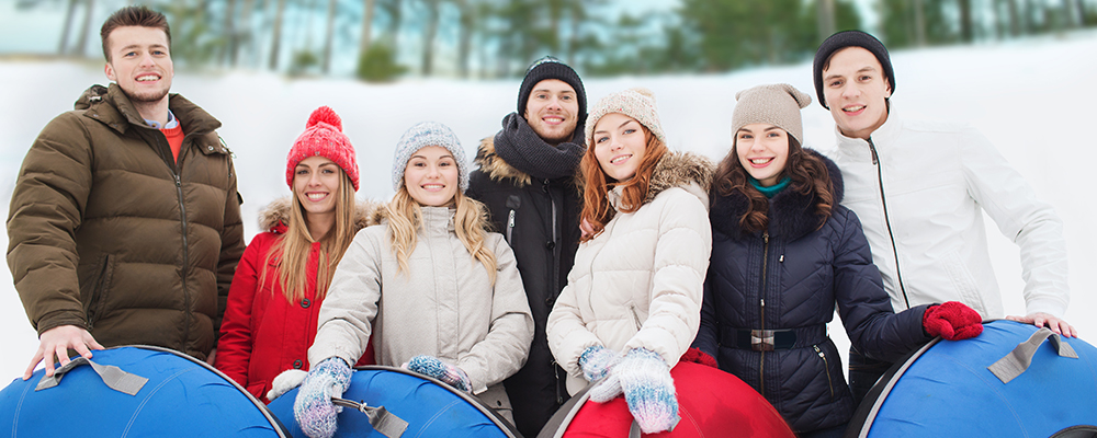 Group of four teen smiling in winter outdoor setting
