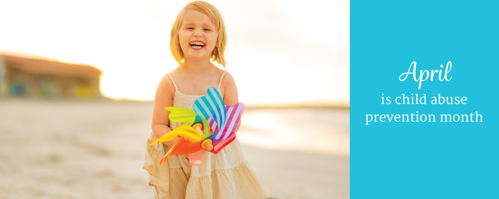 Child holding colorful pinwheel