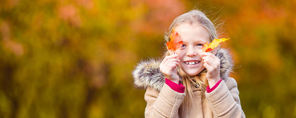 Young girl smiling in fall