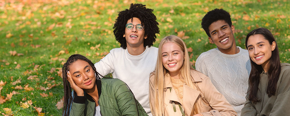 Three teens smiling in fall